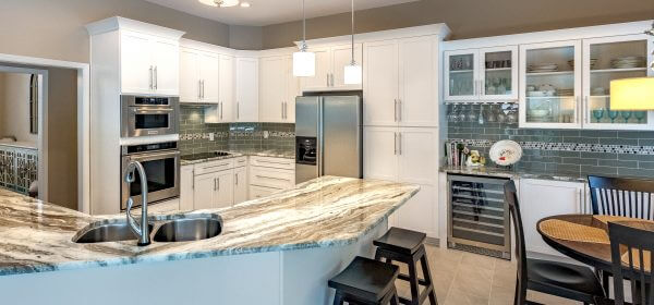 Open floor plan kitchen with custom cabinets