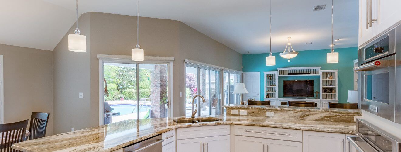 Open floor plan kitchen and living room with Shaker cabinets