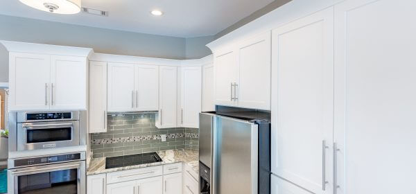Modern crown molding on Shaker cabinets