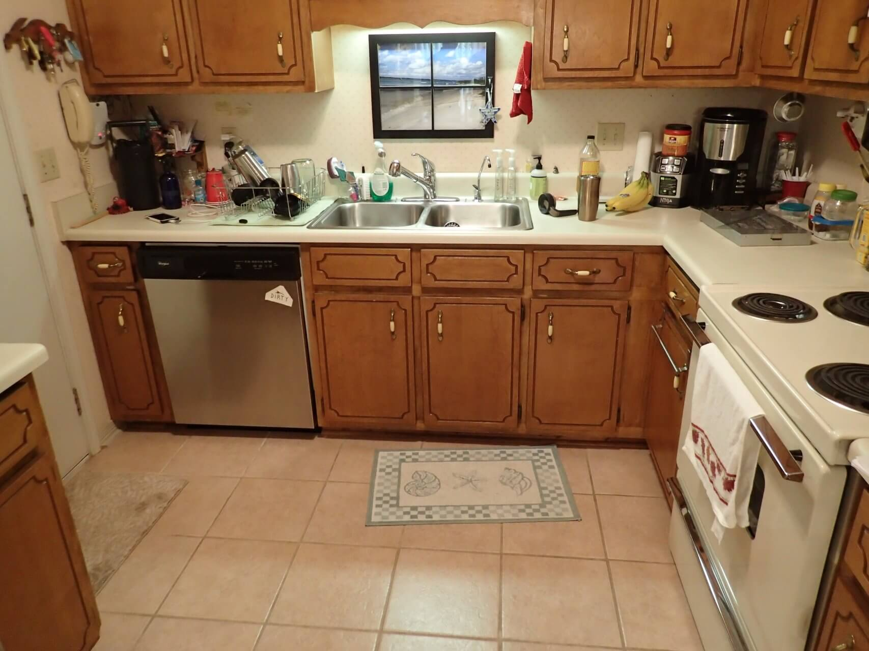 Old kitchen with cluttered countertop