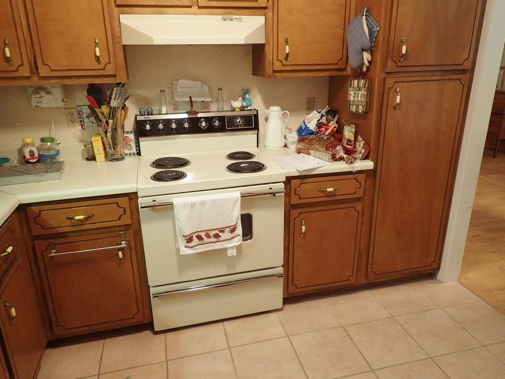 Old kitchen with outdated stove and hood