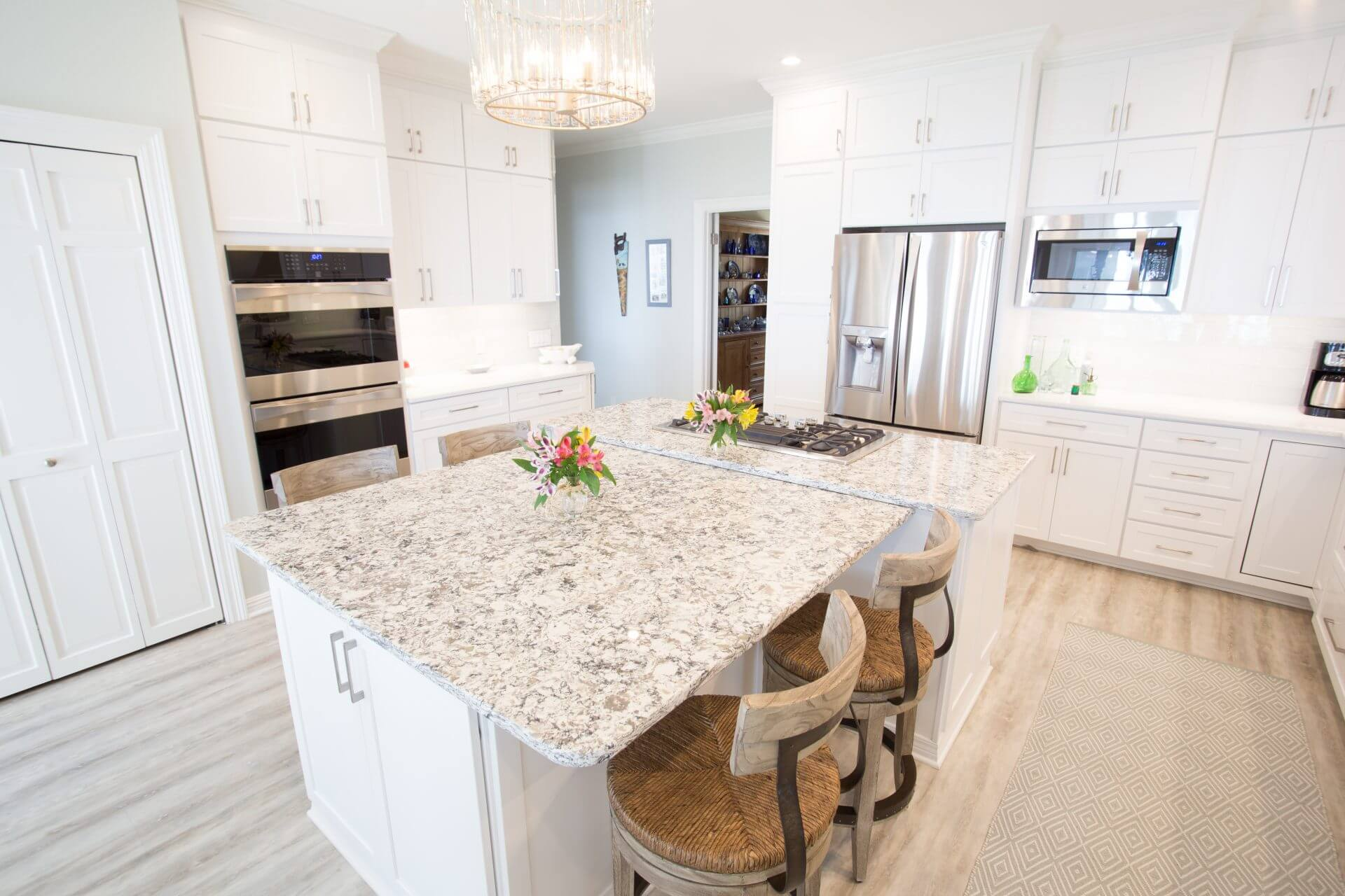 Quartz countertops with white Shaker cabinets and modern hardware