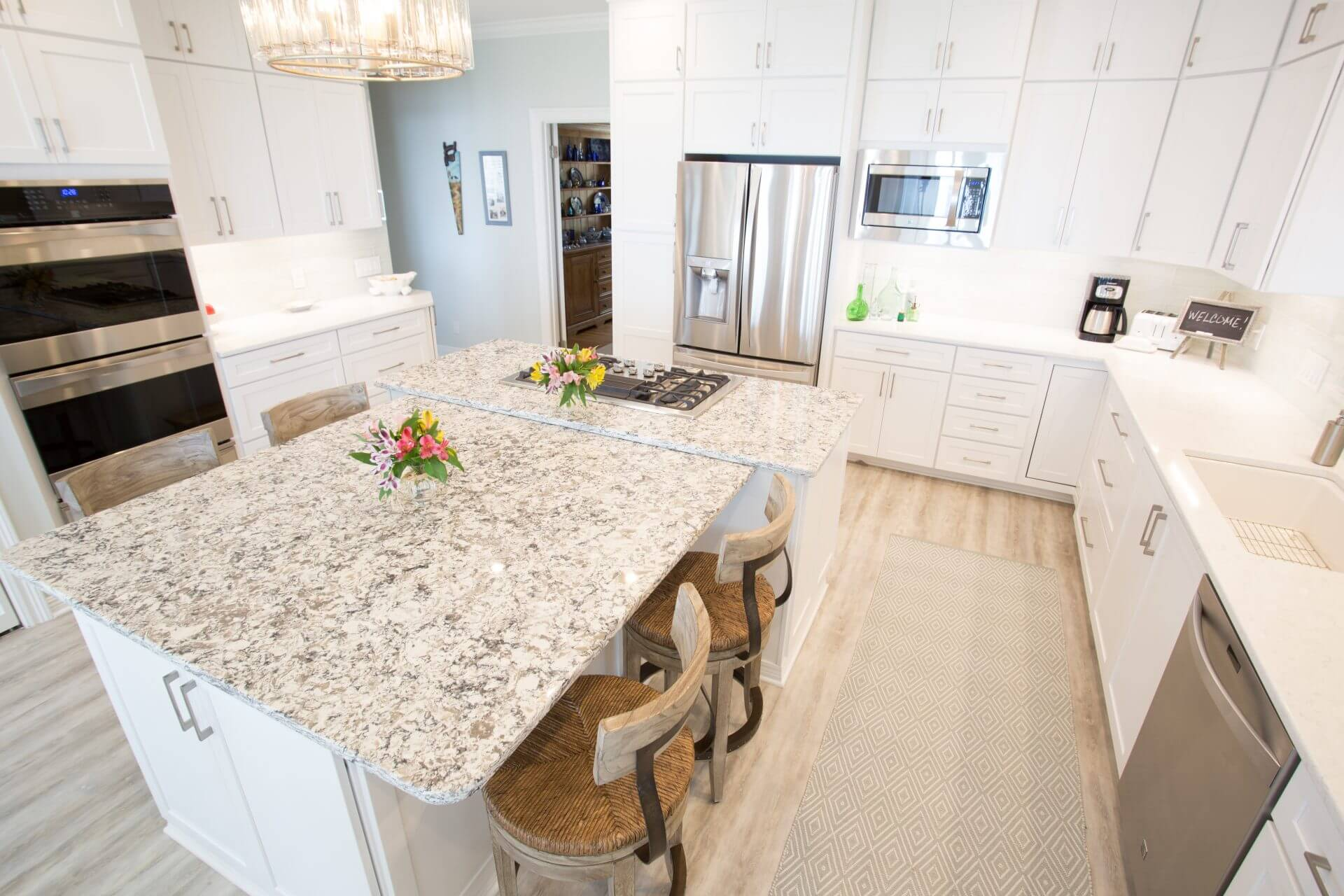 Custom designed kitchen cabinets with quartz countertops and stainless steel appliances