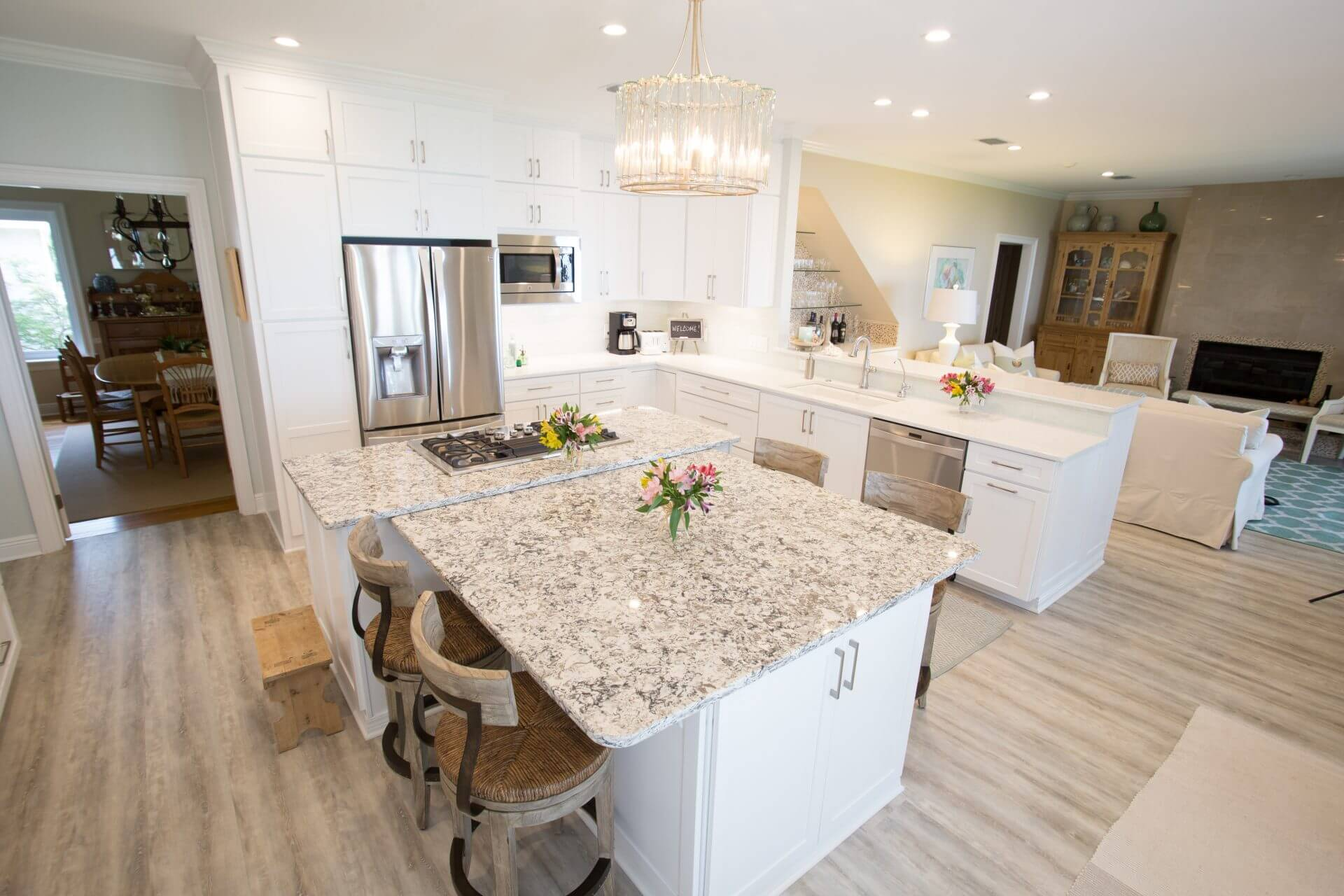 Open floor plan kitchen remodeled with white shaker cabinets.