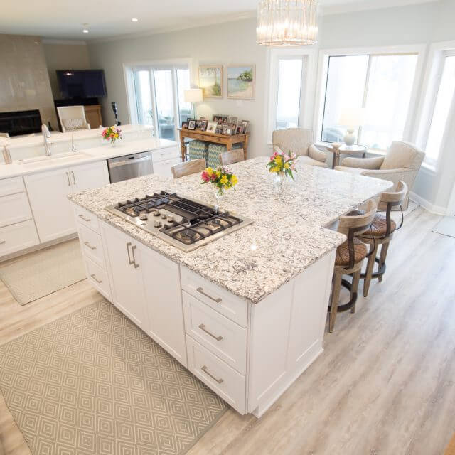 Bright and sunny kitchen remodel with wood floors and white cabinets