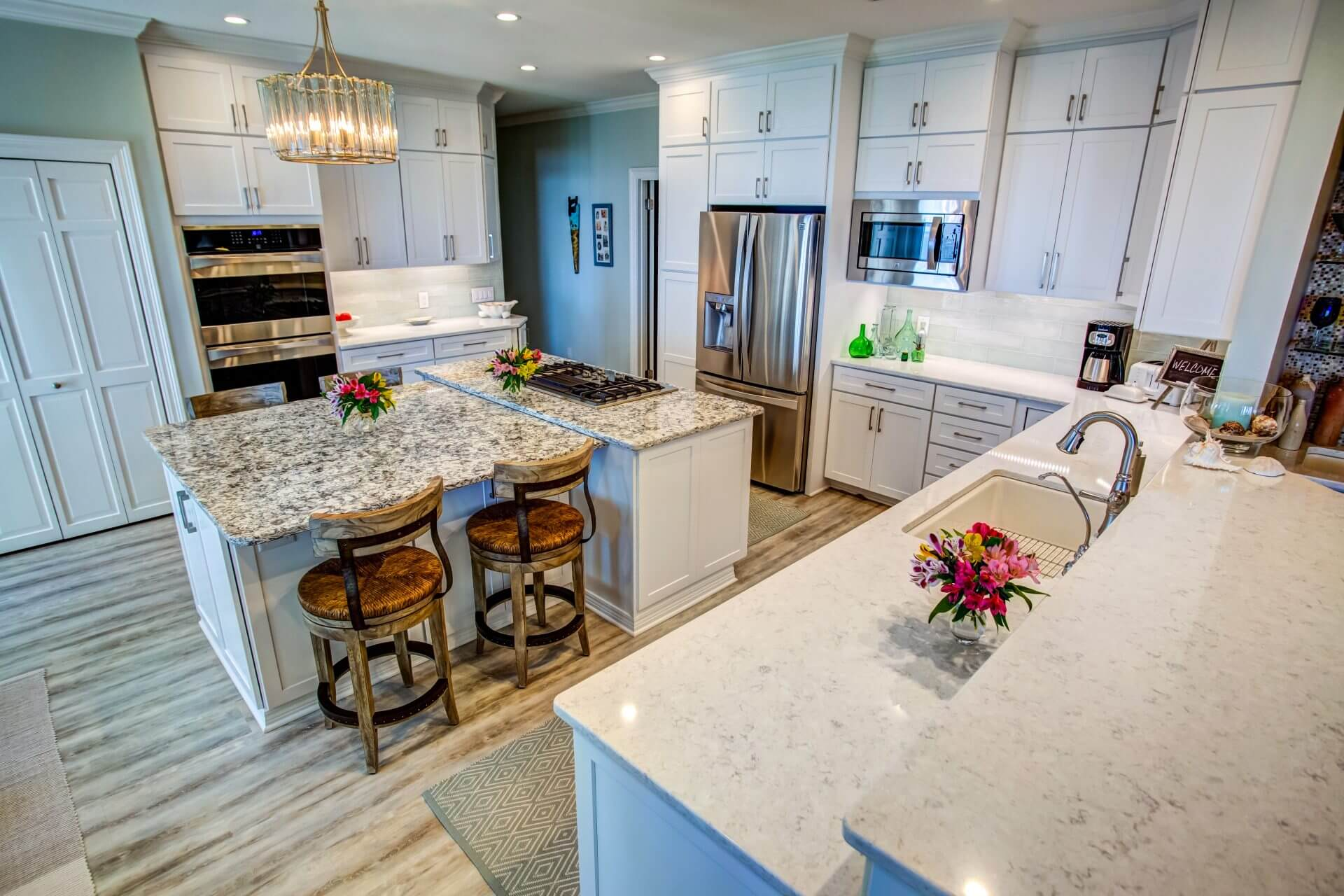 A beautifully remodeled kitchen with white Shaker cabinets.