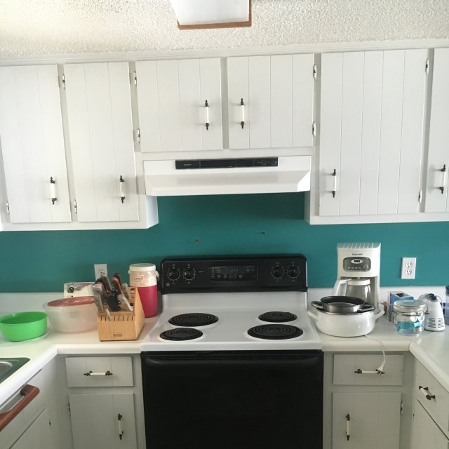 Before picture of beach house kitchen old cabinets and appliances
