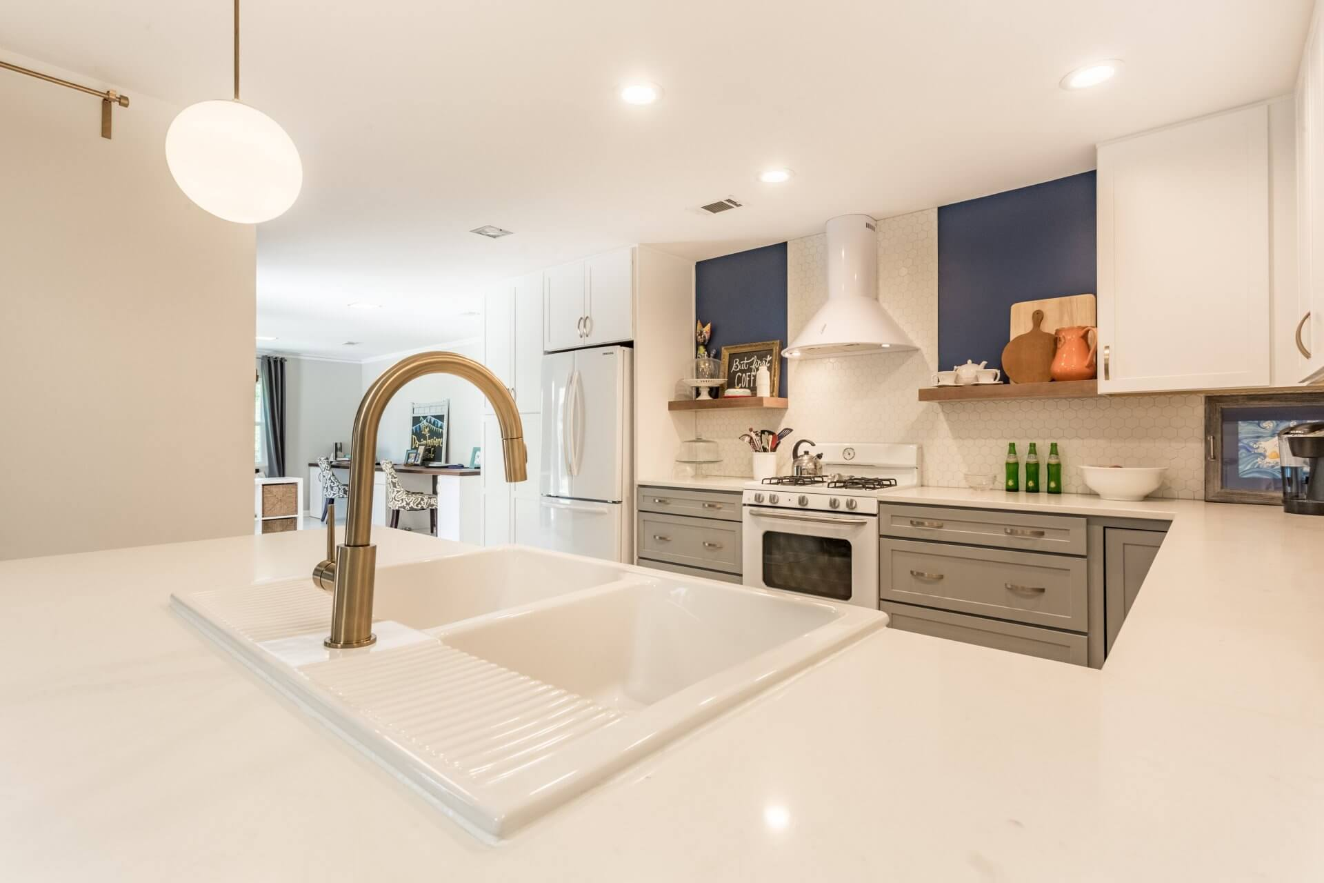 After: Mid-century modern kitchen remodel featuring bronze faucet and double sink