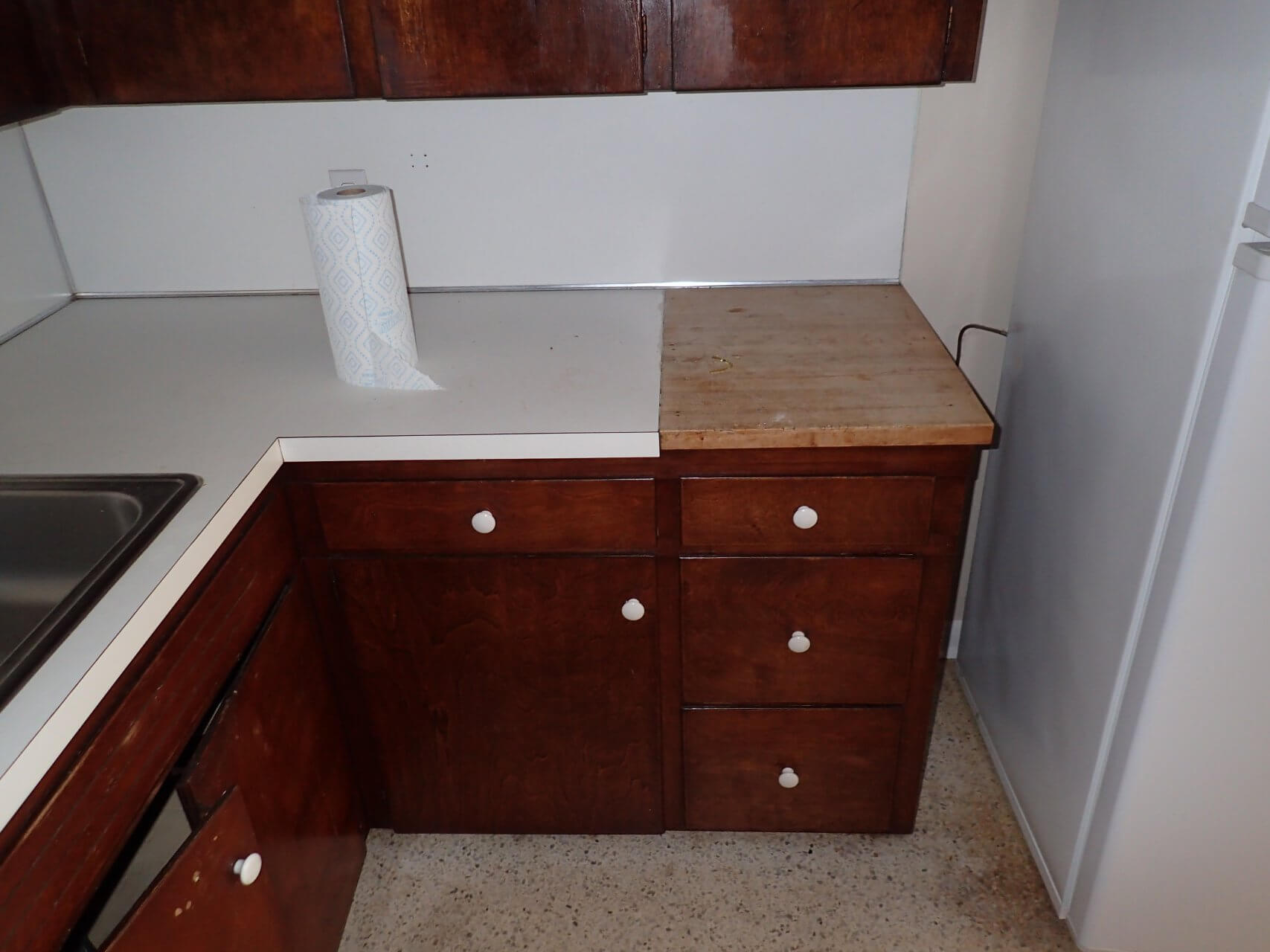 Before: Old kitchen with busted white countertop in kitchen remodel