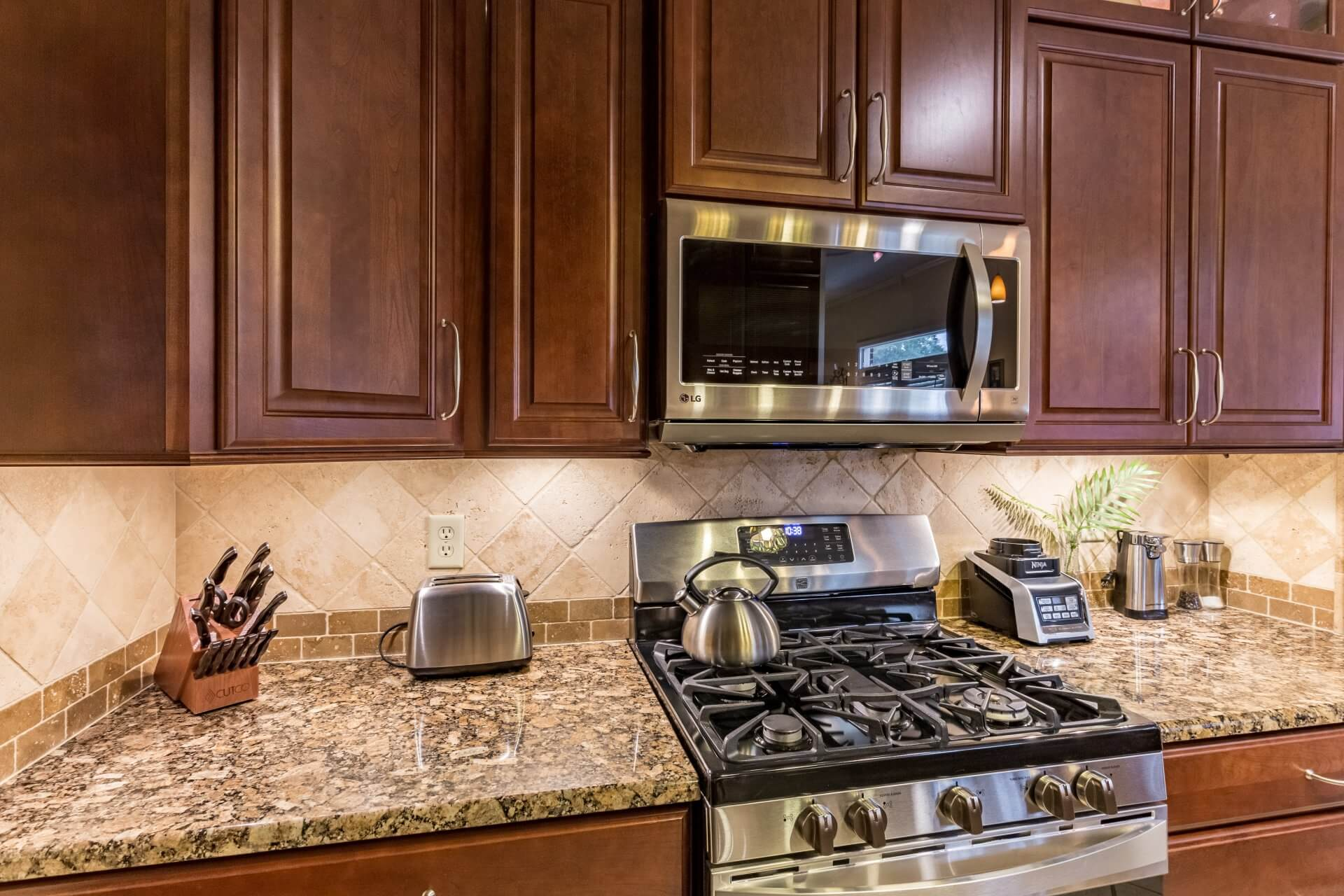After: Updated countertops with dark and light colors