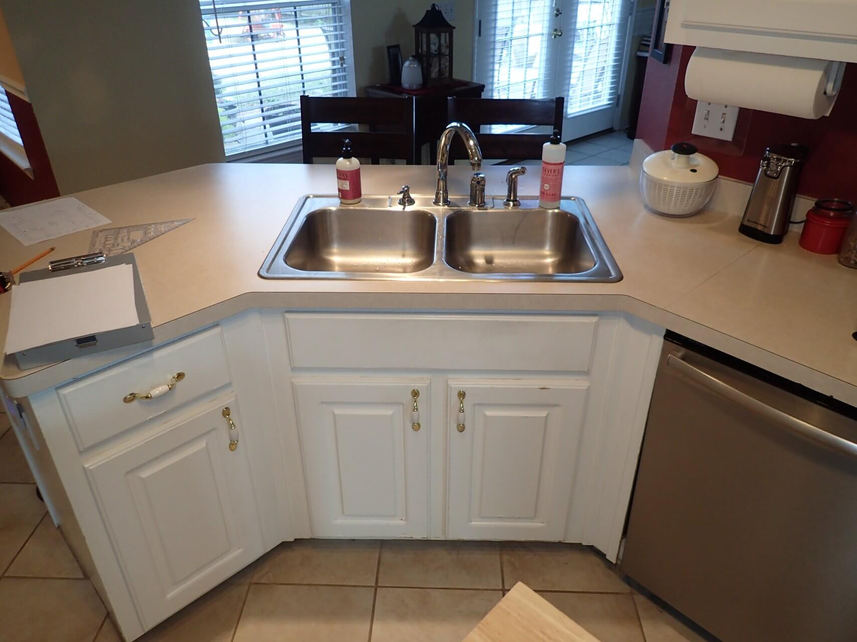 Before - Kitchen sink and bar area