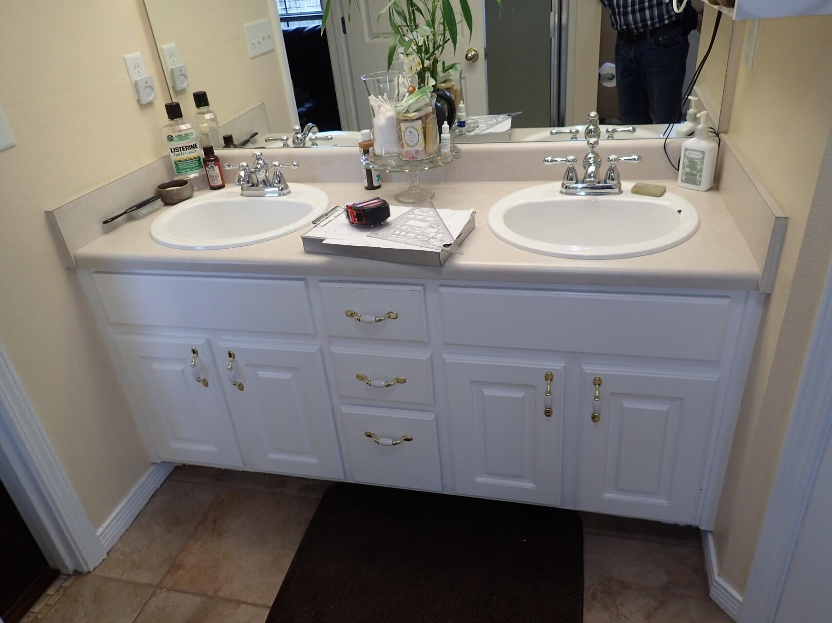 Before: Outdated bathroom counter and sinks