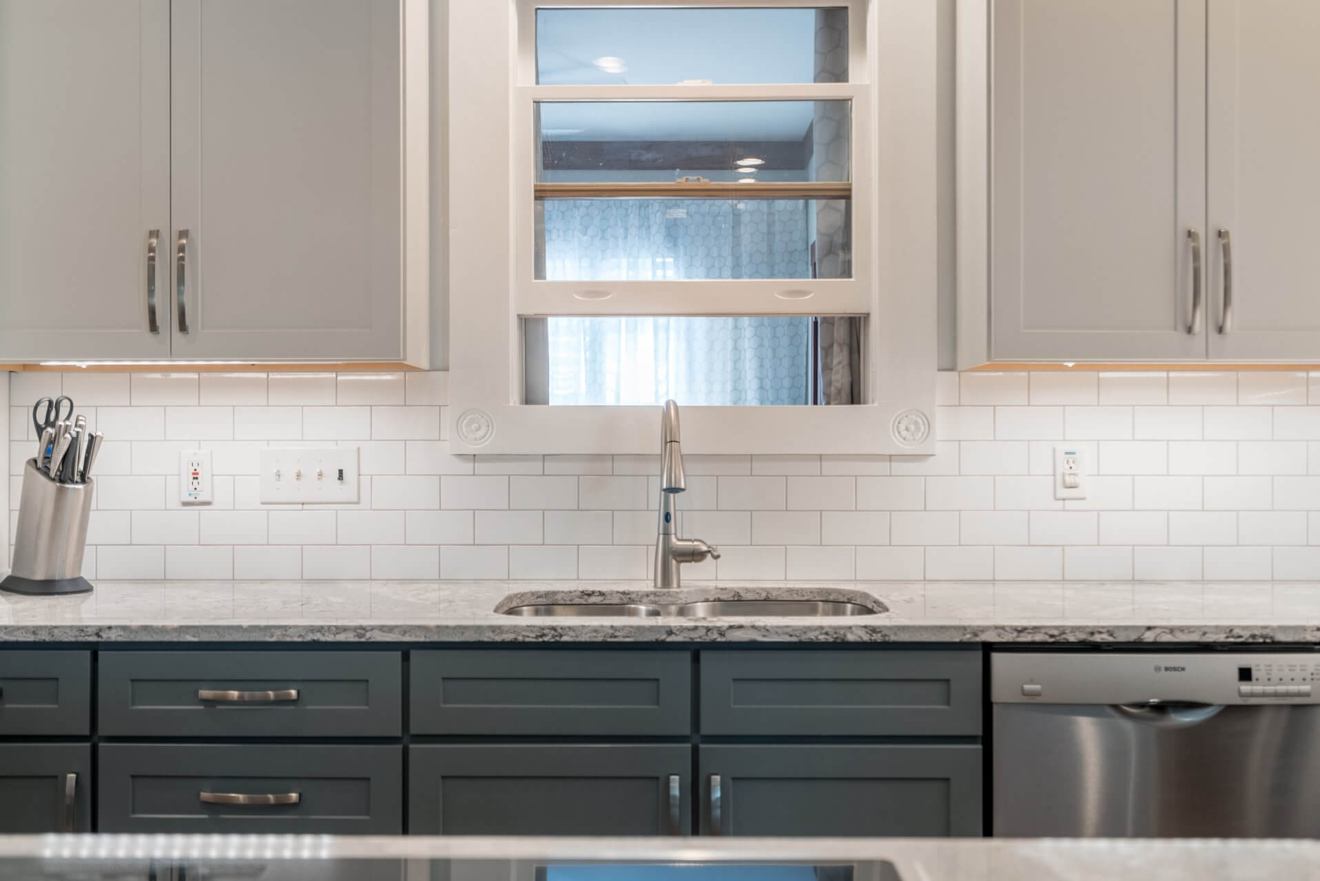 After: A view of traditional white subway tile backsplash used for the kitchen.