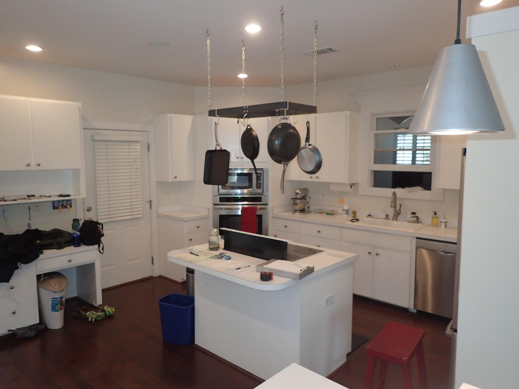 Before: The kitchen featured white cabinets from the ceiling to the floor before Cabinet Depot did renovations.