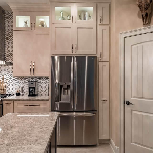 Remodeled kitchen with Dura Supreme's Breckenridge cabinets in Classic White painted finish