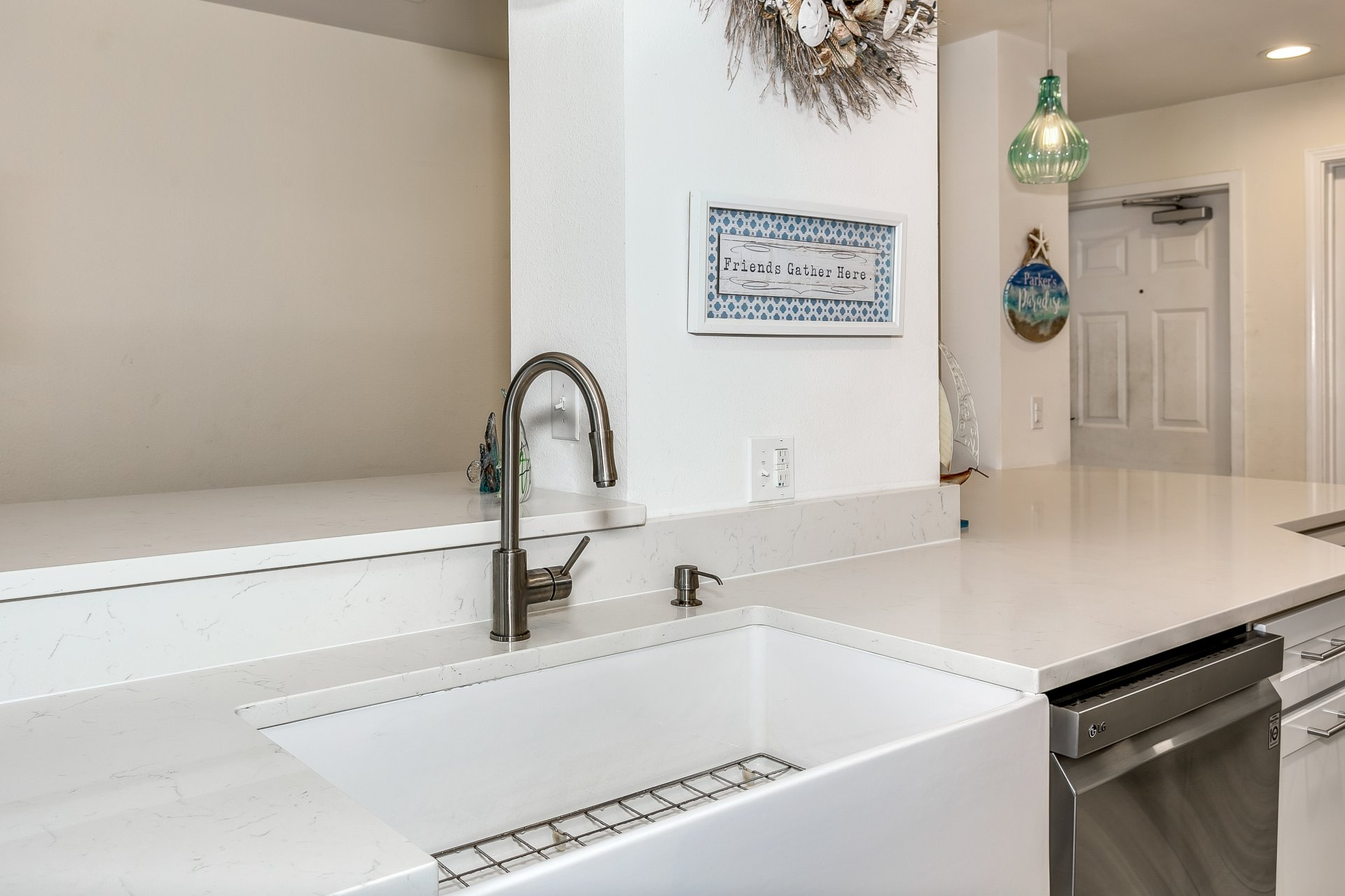 Contemporary farmhouse sink in condo kitchen remodel