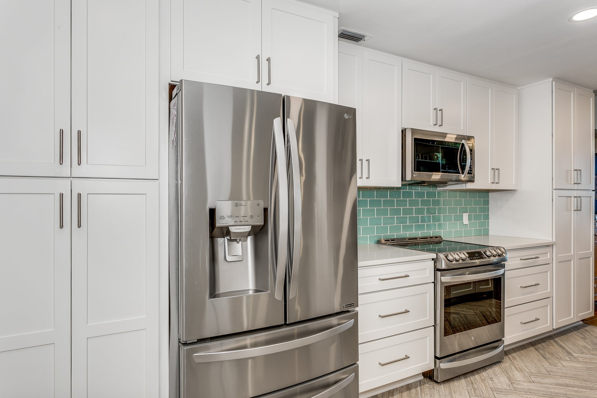 Stainless steel appliances and brushed satin nickel door and drawer pulls
