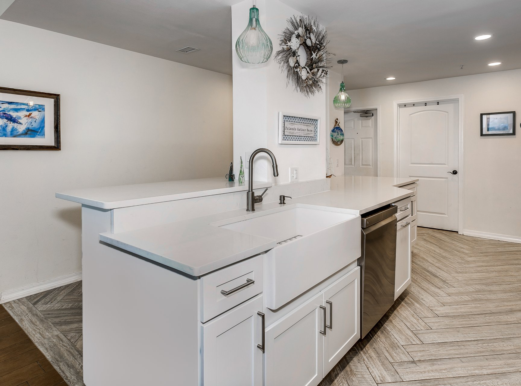 Storage, prep and eating areas in condo kitchen remodel