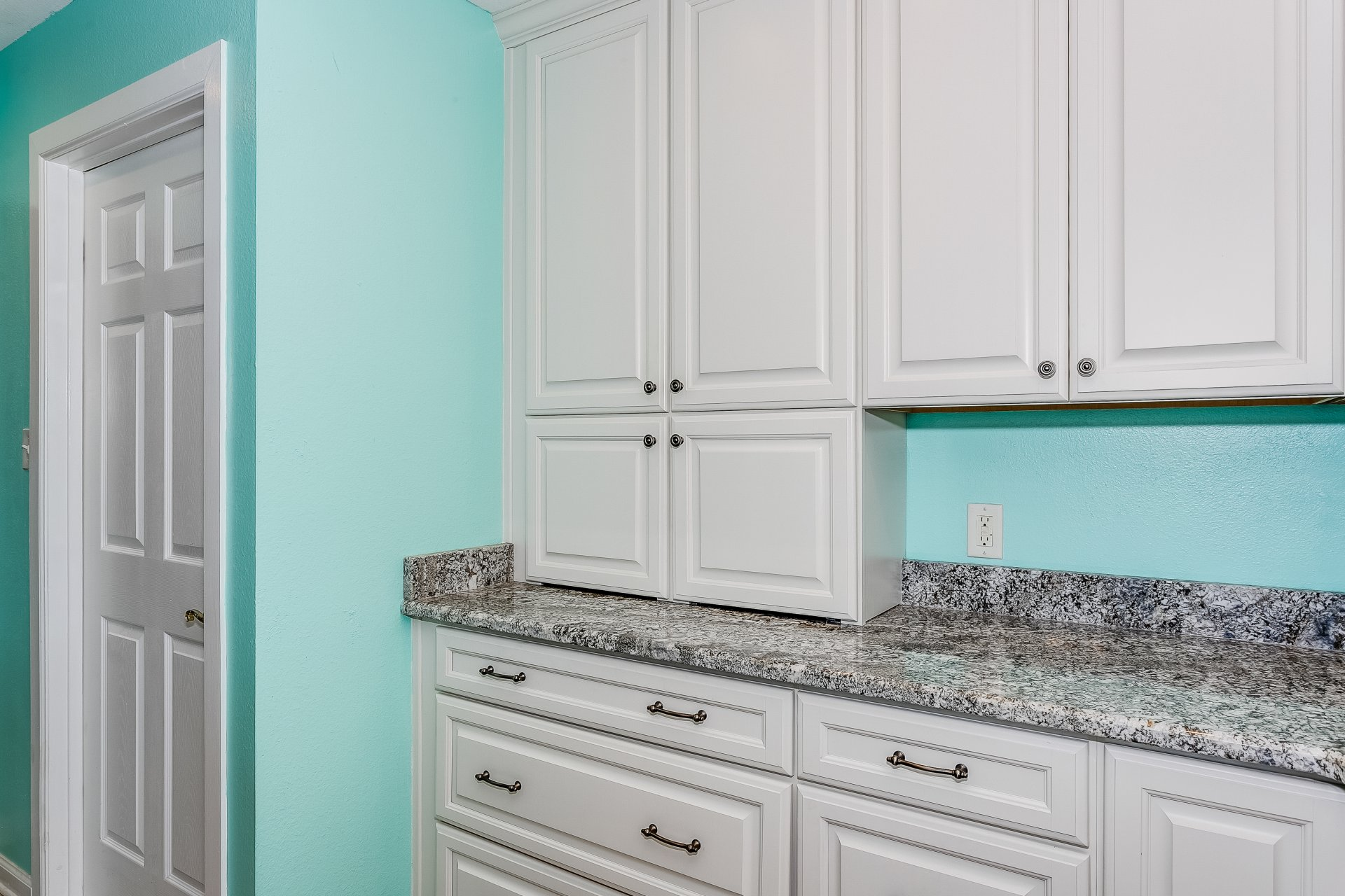 Closed small appliance storage keeps kitchen neat