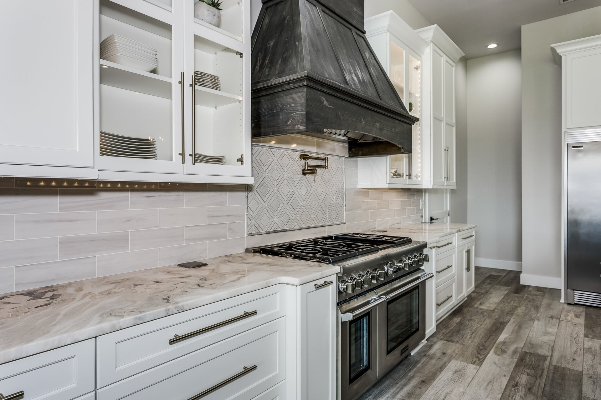 Dramatic tall cabinets in custom new construction kitchen